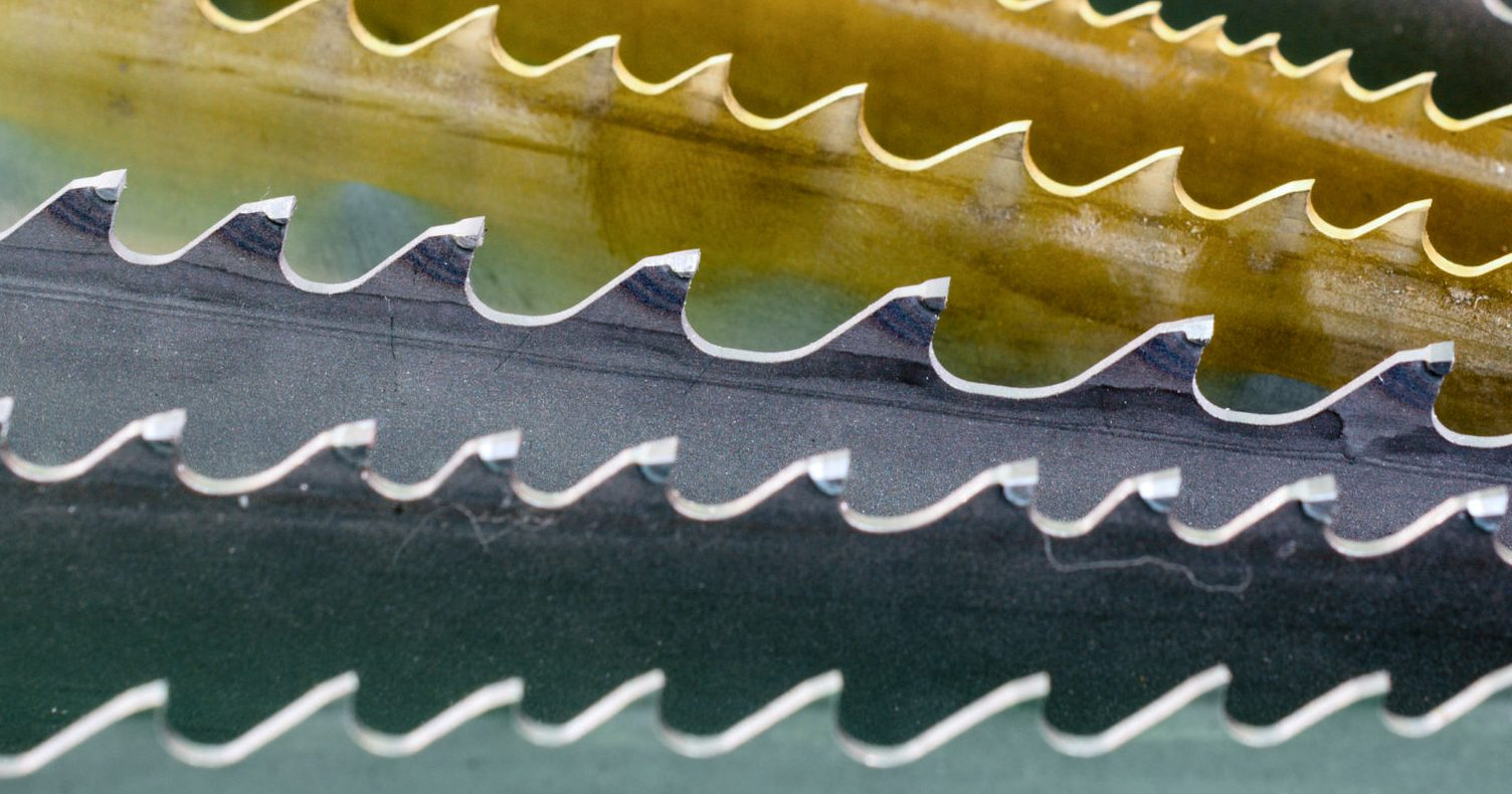 Band saw blade. Fan arrangement, macro. Abstract industrial background